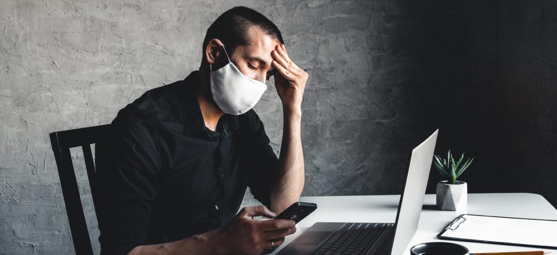 A man Bored during quarantine at the computer. Pandemic epidemic