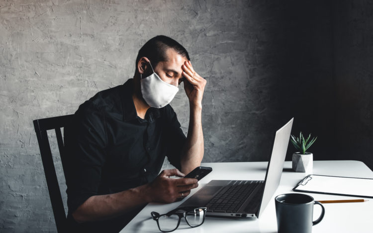 A man Bored during quarantine at the computer. Pandemic epidemic